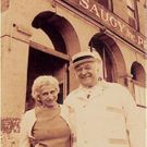 Sophie and Leo McCaughey in front of Saugy building located on Canal St in Providence. At the age of 12, Leo McCaughey, grandfather of the current owner, started working for the Saugy brothers driving a horse-drawn wagon along the cobblestone streets of Providence.